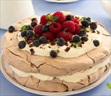 Chocolate Pavlova with Chambord Cream and Fresh Berries