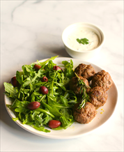 Mediterranean Lamb Meatballs with Cilantro Crema and Arugula-Olive Salad
