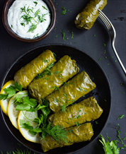 Paleo Lamb-Stuffed Grape Leaves with Tzatziki Sauce and Greek Salad