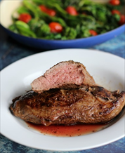Perfect Pan-Seared Teres Major Steaks with Broccoli Raab and Grape Tomatoes