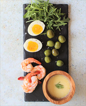 Spanish Tapas Plate of Shrimp, Olives and Eggs with Alioli