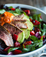 Steak Salad with Arugula, Avocado, Roasted Red Peppers and Macadamia Romesco